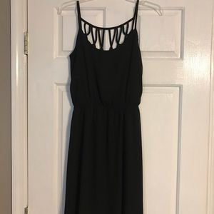 Black dress with cute cross-cross accents.